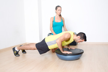 Push-ups on bosu with coach