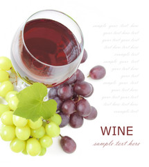 Red wine and grapes with fresh leaves