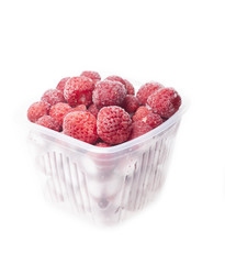 Frozen strawberries in a plastic container on a white background