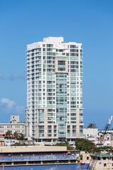 White Condo Building in Puerto Rico on Blue Sky