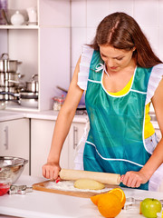 Young woman cooking at kitchen.