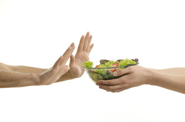 Hand offering a bowl of organic salad and other hands receiving