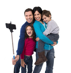 happy young Brazilian family taking selfie photo together