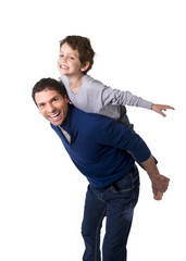 father carrying  little son as airplane flying having fun