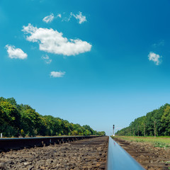 old railroad closeup under deep blue sky