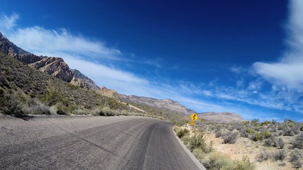 POV motion road trip Red Rock Canyon vehicle motion winter climate Nevada USA