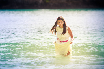 brunette bride stand in sea water