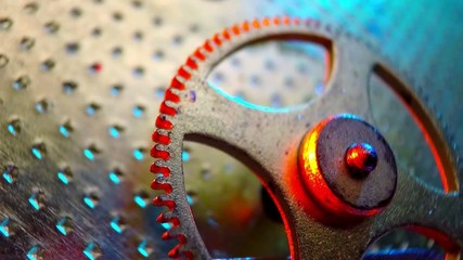 Macro. Metal cogwheels a clockwork.