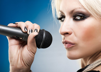 Close up of blonde woman with microphone