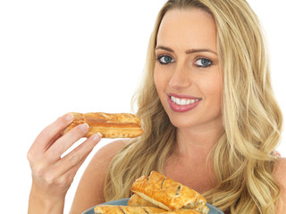 Young Woman Wirth a Plate of Sausage Rolls