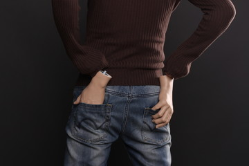 four  hands in pockets, holding his hands in pocket