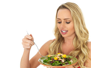 Attractive Young Woman Eating a Prawn Salad