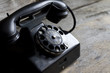 Old retro telephone on vintage boards - 76985939