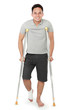 young man with broken leg use crutches