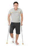 young man with broken leg use crutches