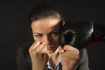 Boxing business woman defending effectively from a punch