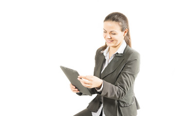 Woman using digital tablet, happy, isolated on white background.