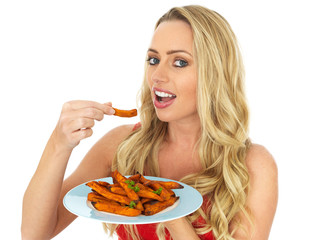 Healthy Young Woman Holding a Plate of Sweet Potatoes