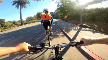 POV couple bicycle riding rural roads cyclists healthy lifestyle  USA