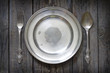 Old retro cutlery and plate on vintage boards