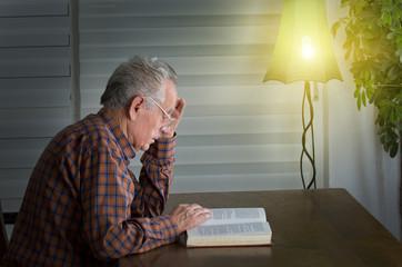 Older man reading a book