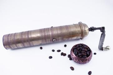 Vintage coffee grinder on white
