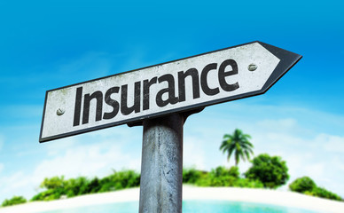 Insurance sign with a beach background