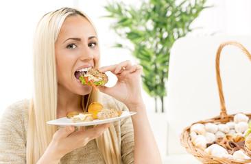 Beautiful Blonde Eating Sandwich
