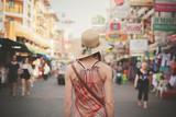 Fototapety Young woman walking in Khao San, Bangkok