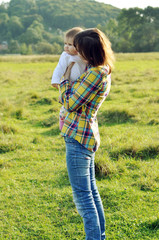 Young Mother with her baby girl watching the nature