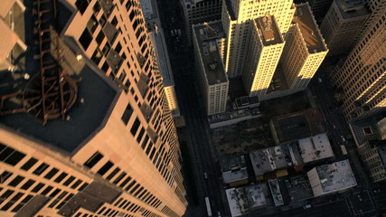 Aerial vertical view of rooftop city buildings traffic, USA