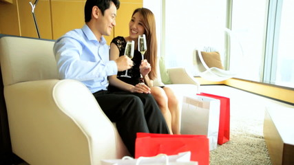 Ethnic Asian Chinese Male Female Couple Shopping Wine Luxury Hotel