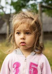 Closeup portrait of a little cute girl outdoors