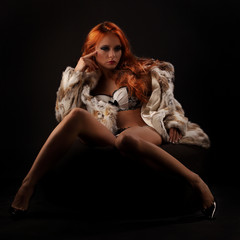 Photo of sexual beautiful girl is in fashion fur coat