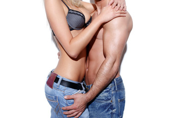 Sexy couple foreplay in jeans at wall