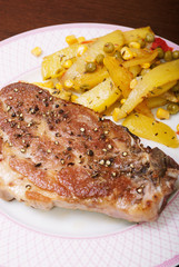 Juicy pork steak and homemade fries