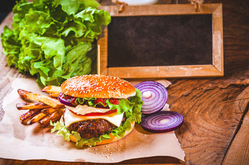 Juicy and fragrant hamburger with fries homemade copy space for