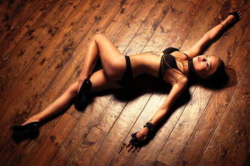 Young sexy woman on floor