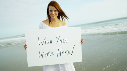 Smiling Young Female Close Up Holding White Message Board