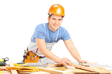 Carpenter working with wooden planks