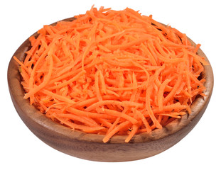 Chopped carrot in a wooden bowl on a white
