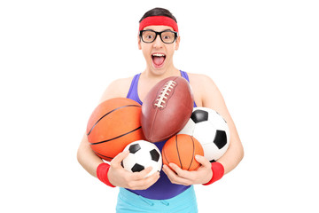 Nerdy guy holding a bunch of sports balls
