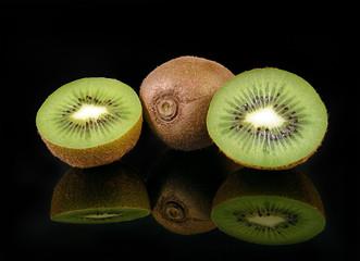 Kiwi fruit isolated on black background, macro