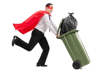 Superhero pushing a full trash can
