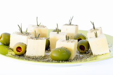 Cheese and olives with rosemary
