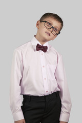 half-length portrait boy in bow tie and glasses