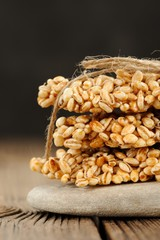 Barley granola bars in pile on rock