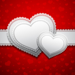 Two lacy hearts on a red background