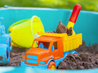 Plastic toys in the sand box