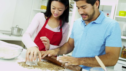 Smiling Asian Chinese Couple Baking Organic Cookies Together